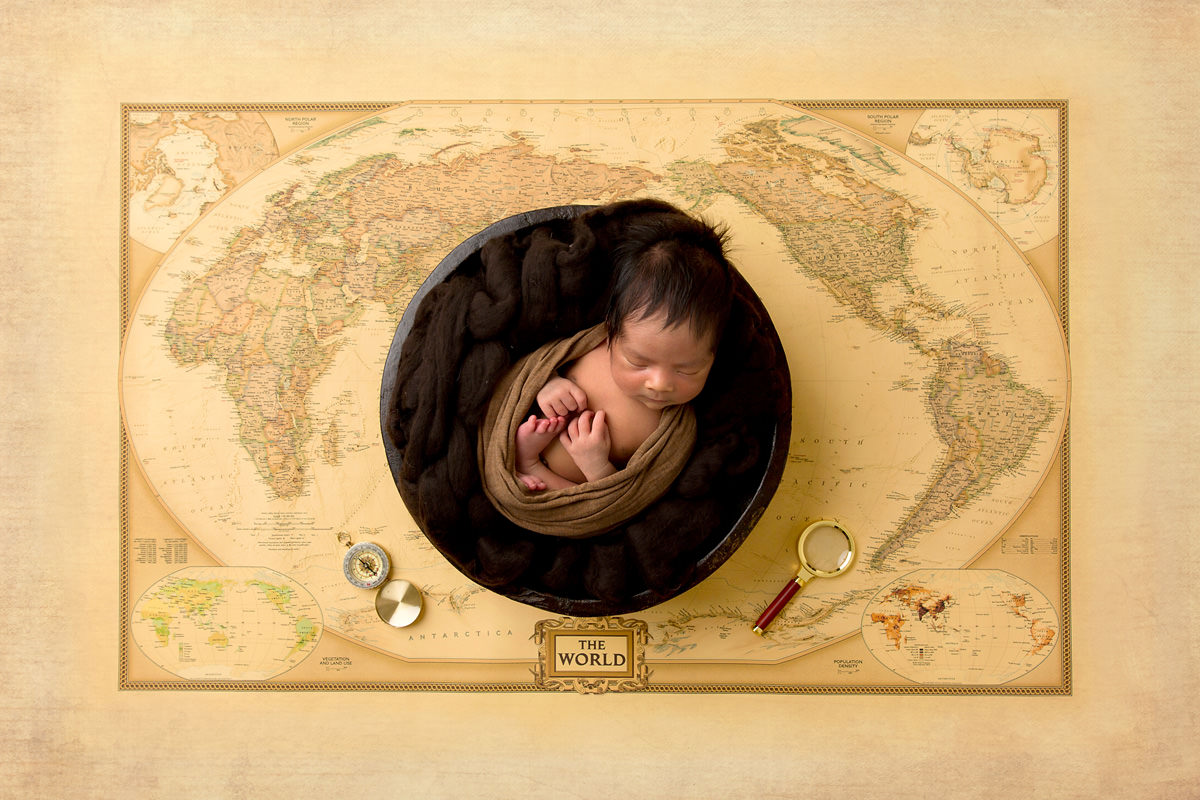 world map travel newborn concept theme photography