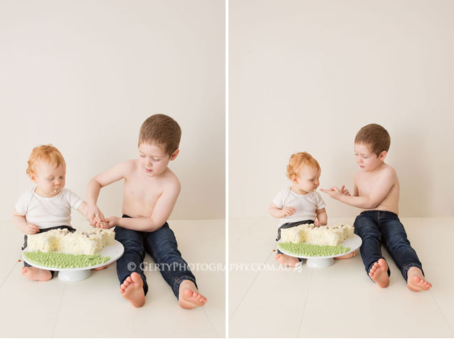Brothers sharing cake