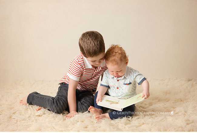 beautiful photo of brothers reading together