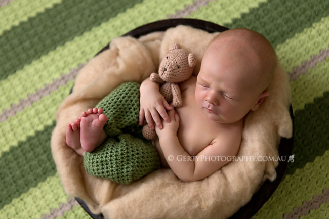 crocheted pants and amigurumi newborn