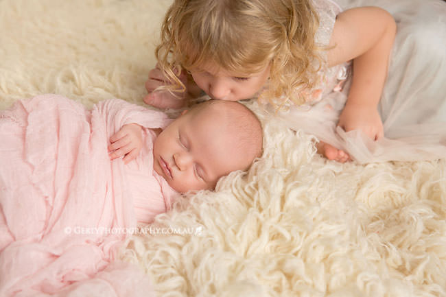 sisters toddler newborn studio photo