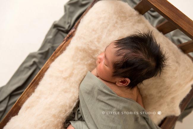 tiny wooden bed newborn photos brisbane