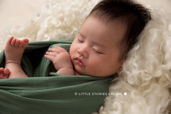 green and cream newborn studio portrait